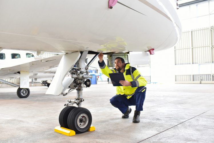 Ground,Personnel,At,The,Airport,Check,The,Hydraulic,System,Of